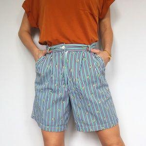 Knee length striped golf shorts